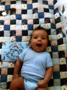 Grandson Marcel on his quilt